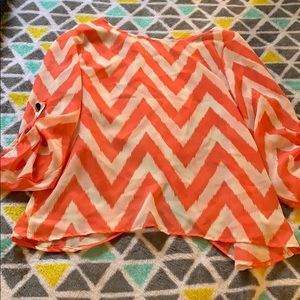 Chevron shirt with slit in back size S